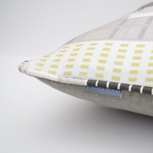 High end designer cushion, with a geometric print inspired by a New York Cityscape.