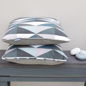 Unique and one off luxury cushions. The diamonds print in Emerald has a rich dramatic style with a bold geometric design. Created and produced in the UK.