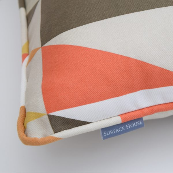 Luxury Handmade Jester style cushion with brightly coloured triangle print. Created in the UK.