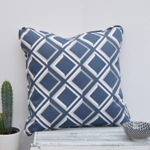 Lattice Trompe L'oeil style blue geometric cushion. Create a contemporary focal point in an interior by placing this cushion of your favourite chair.