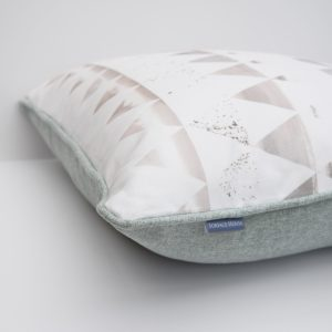 High end soft furnishings for luxury interiors. This unique triangle cushion is the perfect accessory for a minimalist designer interior.