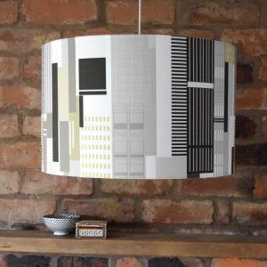 Modern and minimalist, our New York Lampshade is an elegant white, grey and black instant update for your living room, bedroom or office.