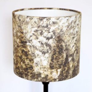 High End lampshade design by Surface House. Gold painted forest scene lampshade with matching cushions and wallpaper available too.