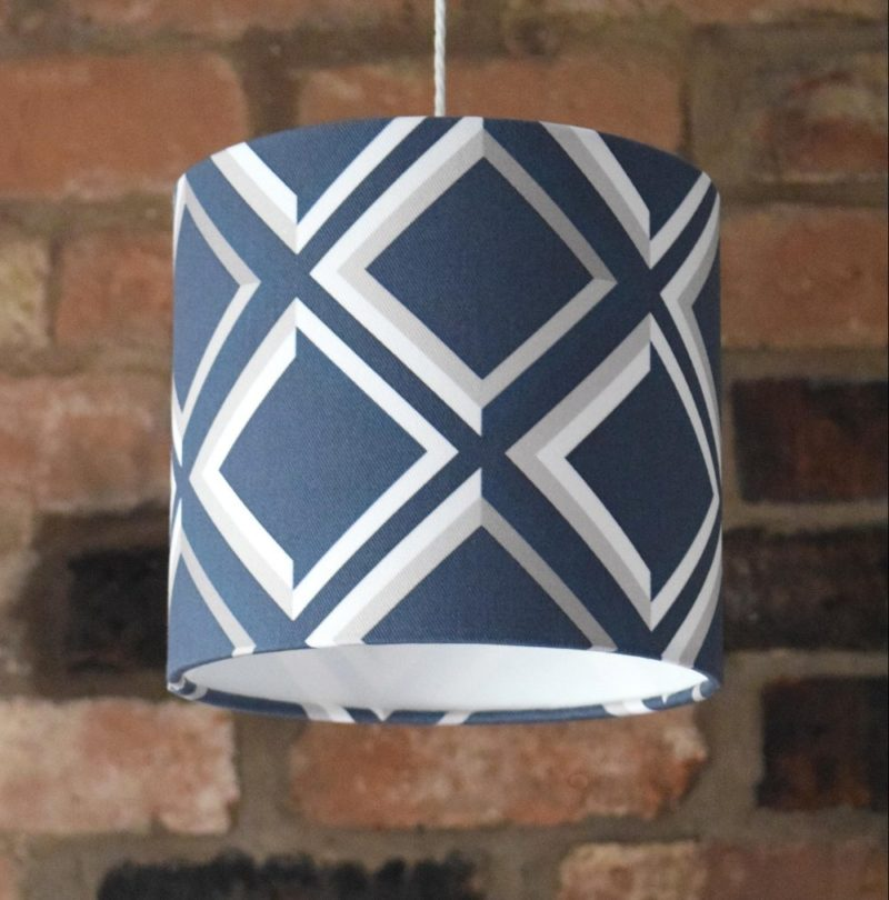 Blue geometric Designer Lampshades collection. handmade and beautifully detailed. The trompe l'oeil print effect is most eye-catching.