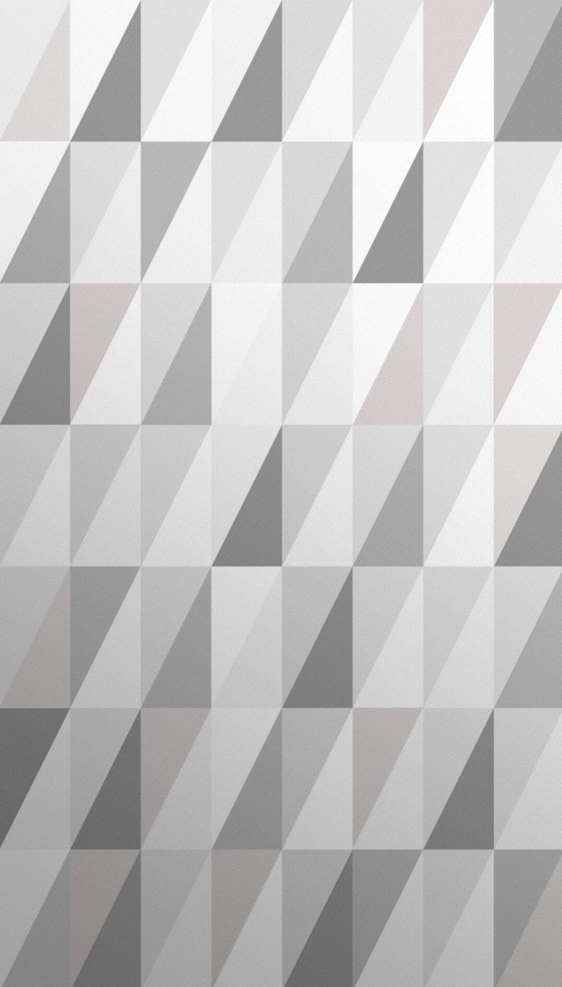 Grey wallpaper with cascading triangles. Shimmering shades of grey wallpaper. Simple geometric print for beautiful interiors.