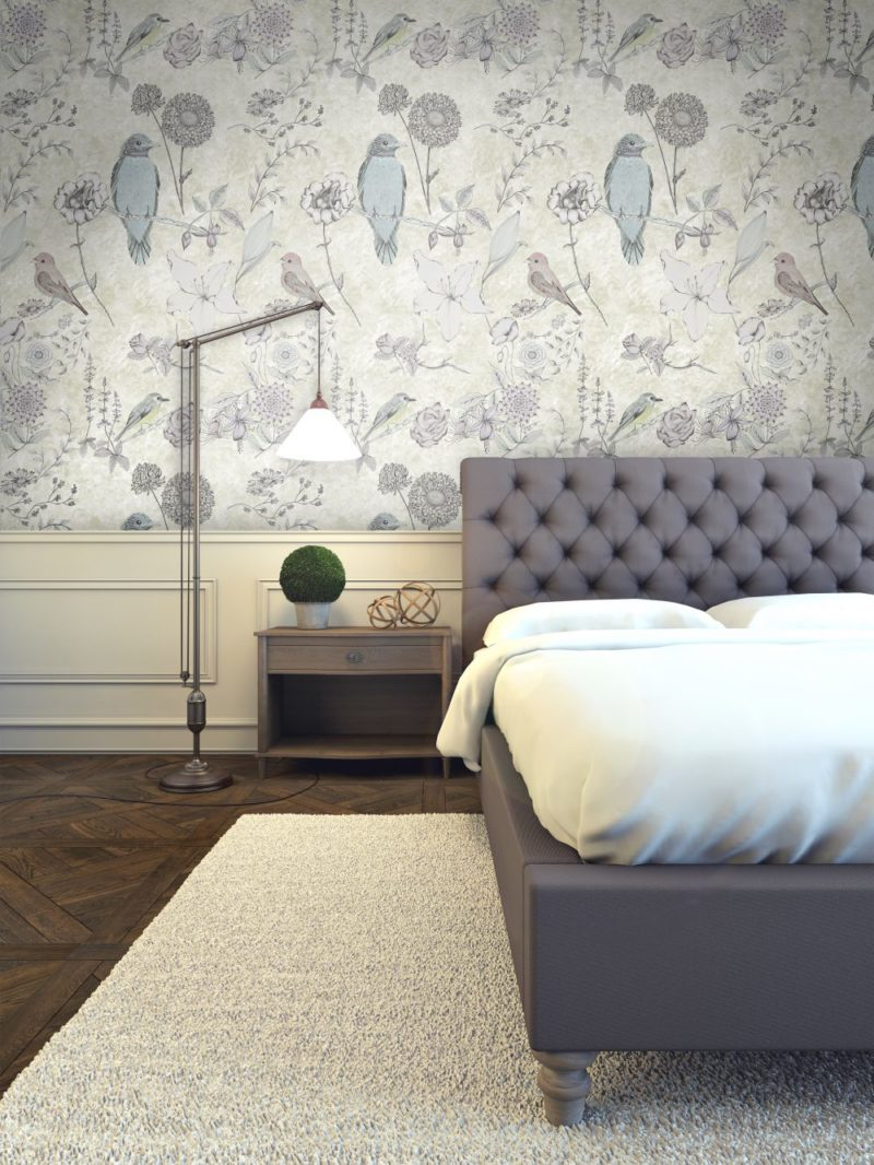 Gold textured effect background with birds and florals interweaving as the design. A wallpaper for opulent interiors.