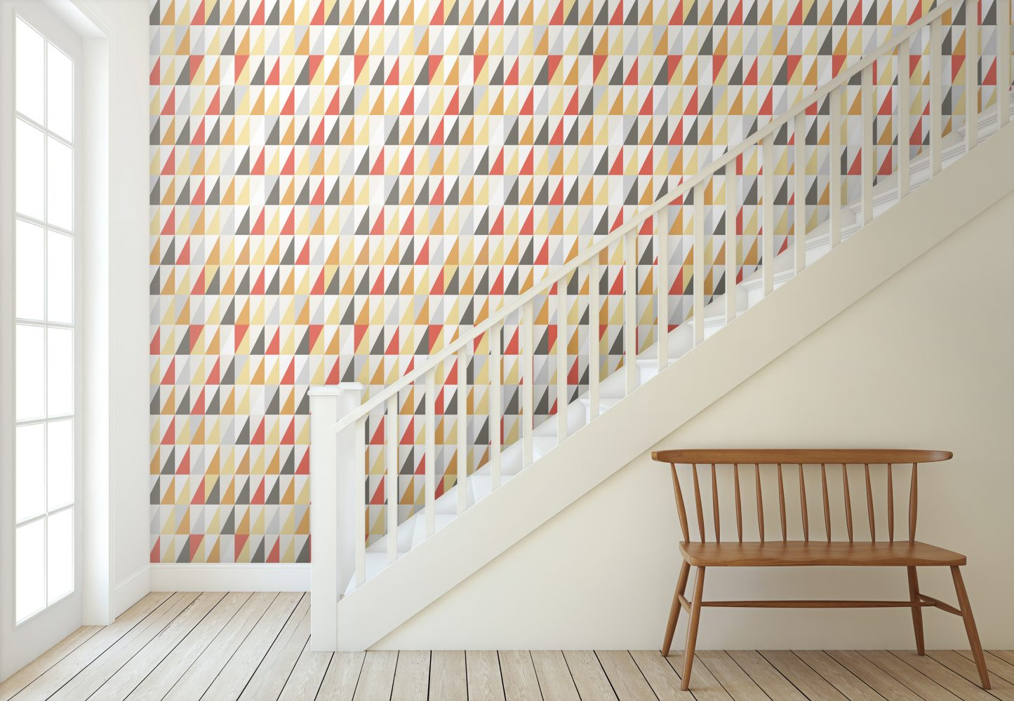 Geometric triangle wallpaper with jester colours, retro orange, red, mustard yellow, black and white.